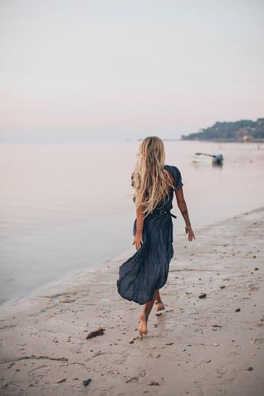 woman at the beach walking