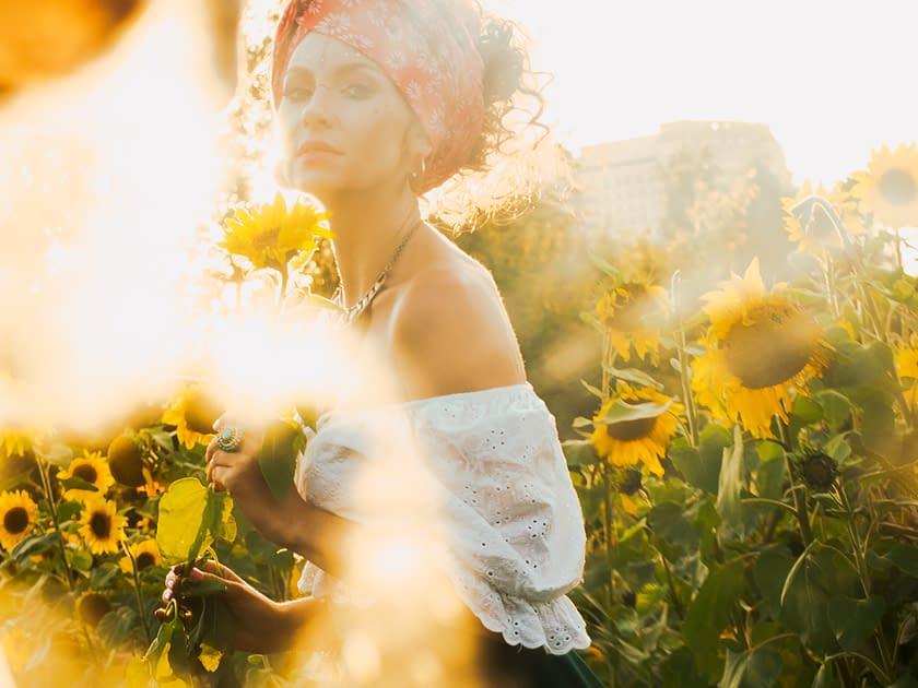 woman in a flowerfield, sun is shining