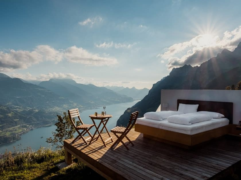 a bed high up on a terrace in the mountains