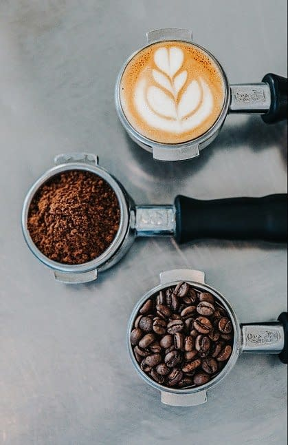 from coffee beans to grounded to a cup of coffee
