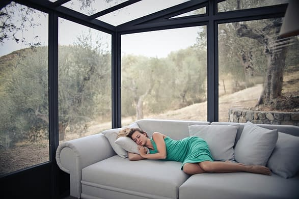 woman sleeping on a sofa in the living room