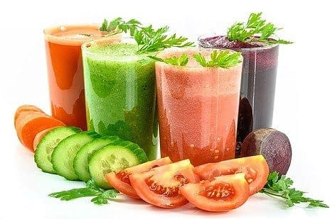 different glasses with vegetable and fruit juice