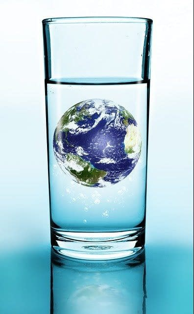 a glass of water with the globe in it
