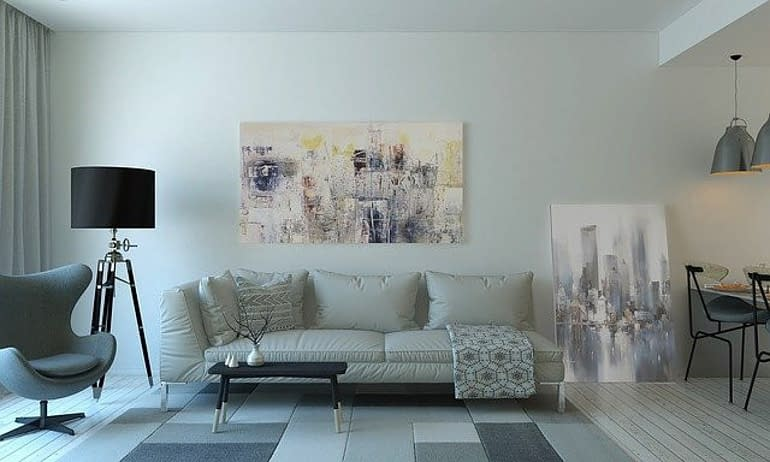 a living room with sofa, lamp, modern