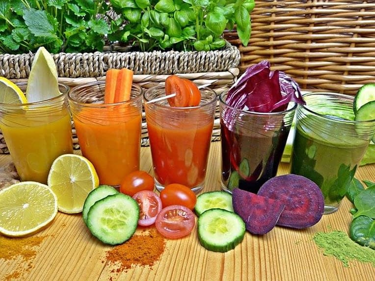 different smoothie in glasses, different colors