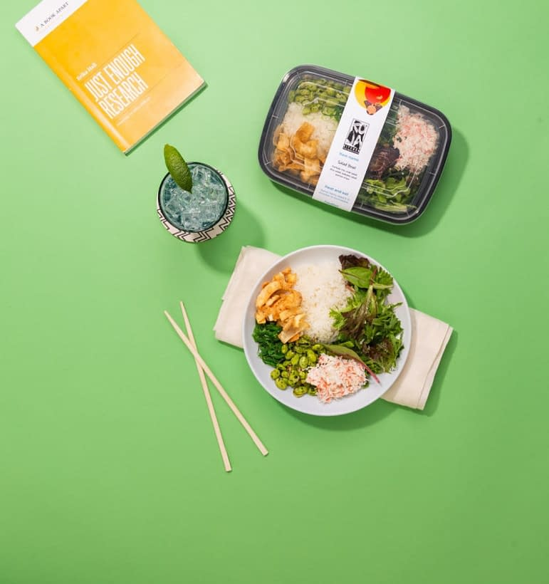 an industrial made asian food in a package, and the same food on a plate