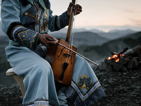The Healing Benefits of Music -Listen up, a native playing an instrument