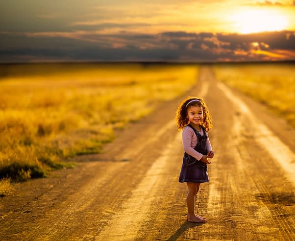 small girl in a sunset on a path