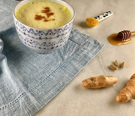 a cup with tumeric milk