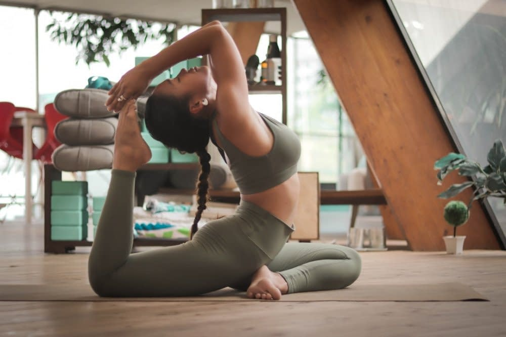 a woman performing yoga