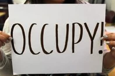a board written on occupy