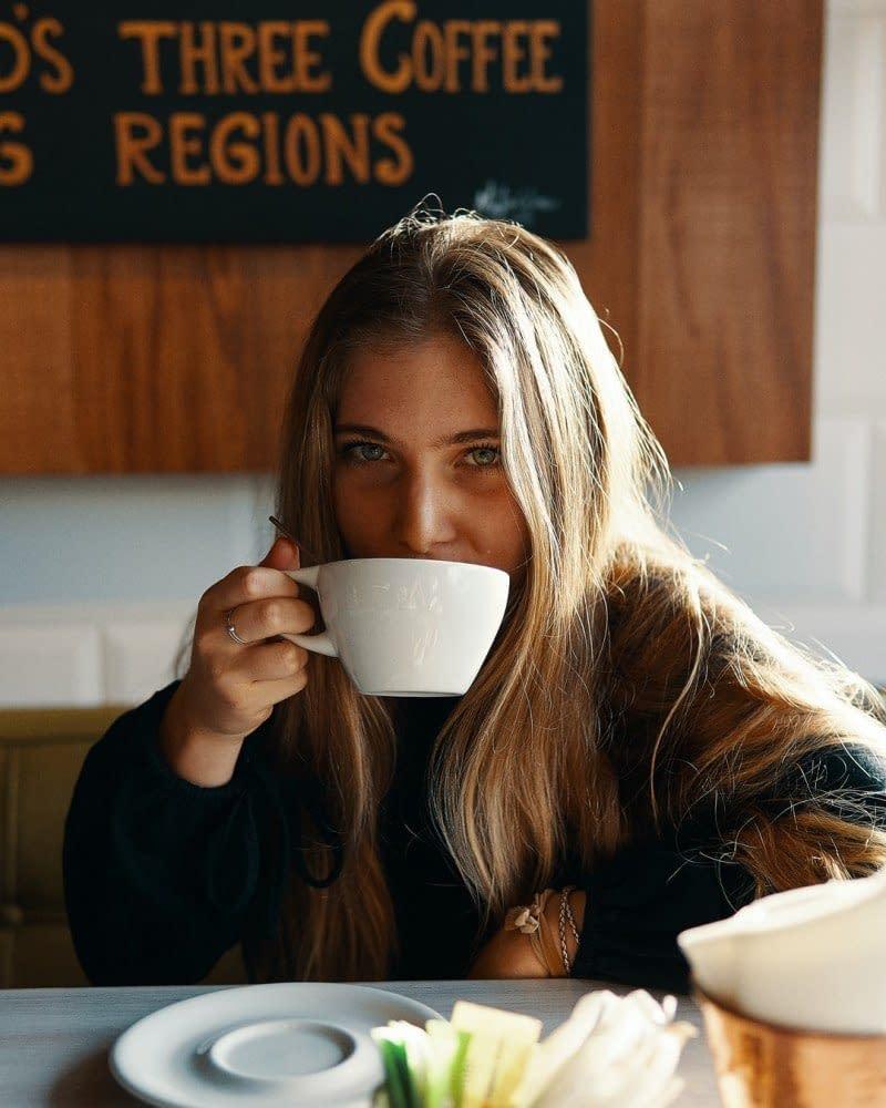 blond woman drinking coffee