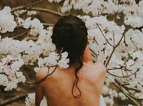 woman surrounded by blossoms