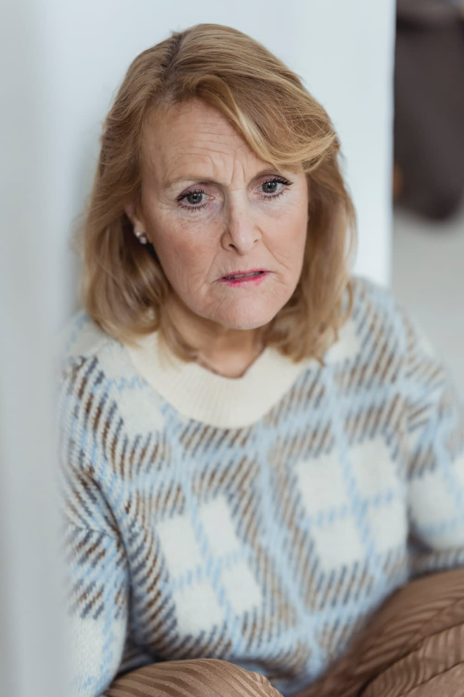 a sad middle-age caucasian woman